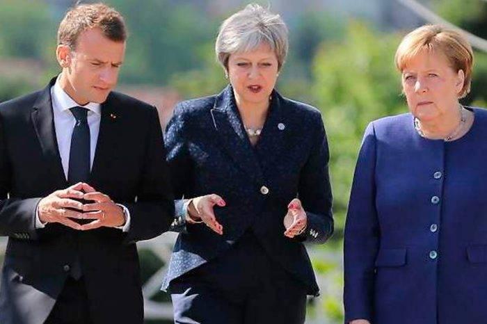 Emmanuel Macron, Teresa May y AngelaMerkel